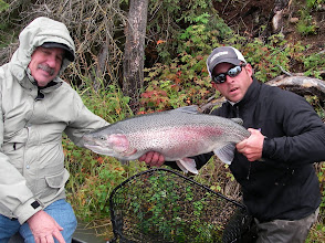 Photo: Nick Ohlrich of Alaska Drift Away Fishing holding a clients 30 inch long by 20 inch girth Kenai rainbow trout.