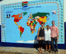 Photo: Volunteers from the community with Hilsinger painted the world map mural at Molema Memorial Primary School.