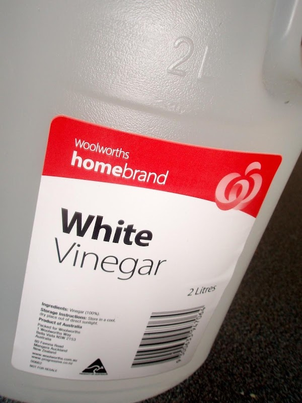 Add in your 1/3 of a cup of white vinegar to the spray bottle...