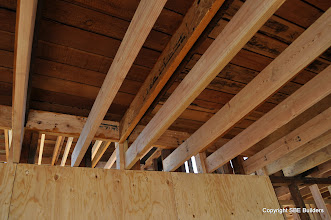Photo: New 1 3/4 x  7 1/4 LVL's sistered to existing roof rafters and new 2x6 ceiling joist.
