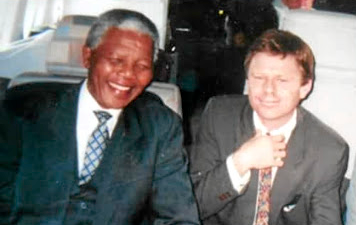 President Nelson Mandela and Patrick Bulger on route from Tokyo to Seoul, South Korea.