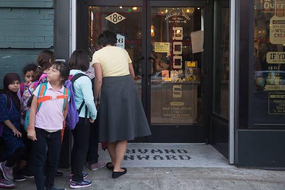 Students wait outside 826's new Tenderloin location