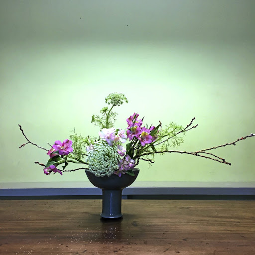 Japanese asymmetrical flower arrangements are as much about the blooms and branches as they are about the beauty of negative space.