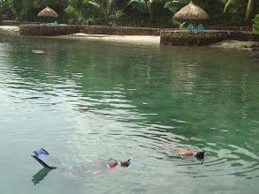Photo: Nick and Tony looking for seahorses at Chindonan Island Resort, Palawan, Philippines.