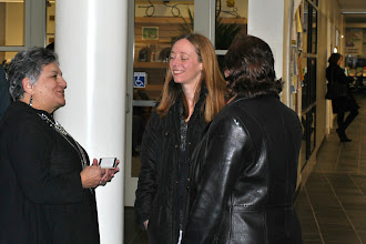 Photo: Artist, Rose Marie Strippoli  left)speaks with our guests.