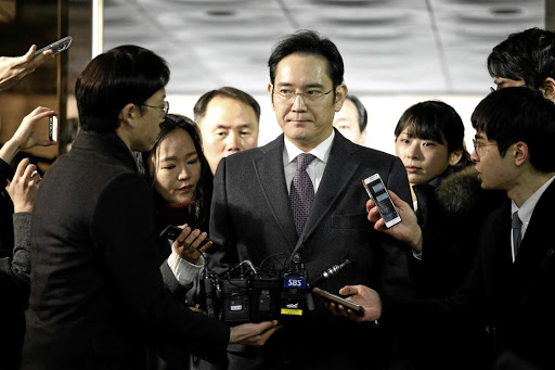 Lee Jae-yong, the vice-chairman of Samsung Electronics, is surrounded by media as he arrives at the Seoul Central District Court in Seoul, South Korea, on January 18 2017. Picture: REUTERS