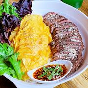 Striploin Steak on Scrambled Egg