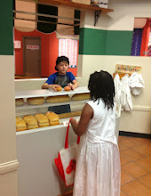 Photo: this boy was doing a great job as the baker