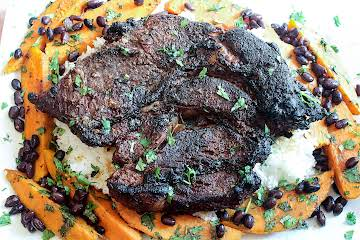 Cuban grilled chuck beef roast with grilled sweet potatoes and black beans