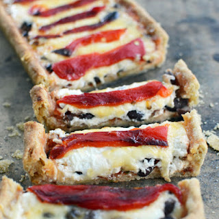 Chipotle Cheese, Black Bean and Roasted Red Pepper Layered Mexican Tart in a Cumin Crust.