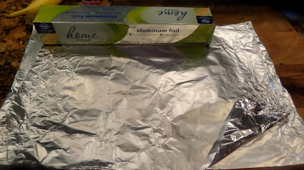 Use a large piece of heavy duty tinfoil, or use two thin pieces long...