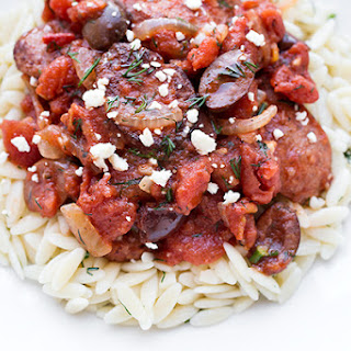 Greek-Style Smoked Sausage Skillet with Olives, Tomatoes and Fresh Dill over Orzo, topped with Feta