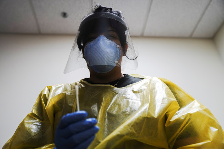 The Covid-19 response specialist Alexandra Vizcarra prepares to administer a nasal swab test at Public Health Madison & Dane County as the coronavirus disease outbreak continues in Madison, Wisconsin, US. Picture: REUTERS/Bing Guan