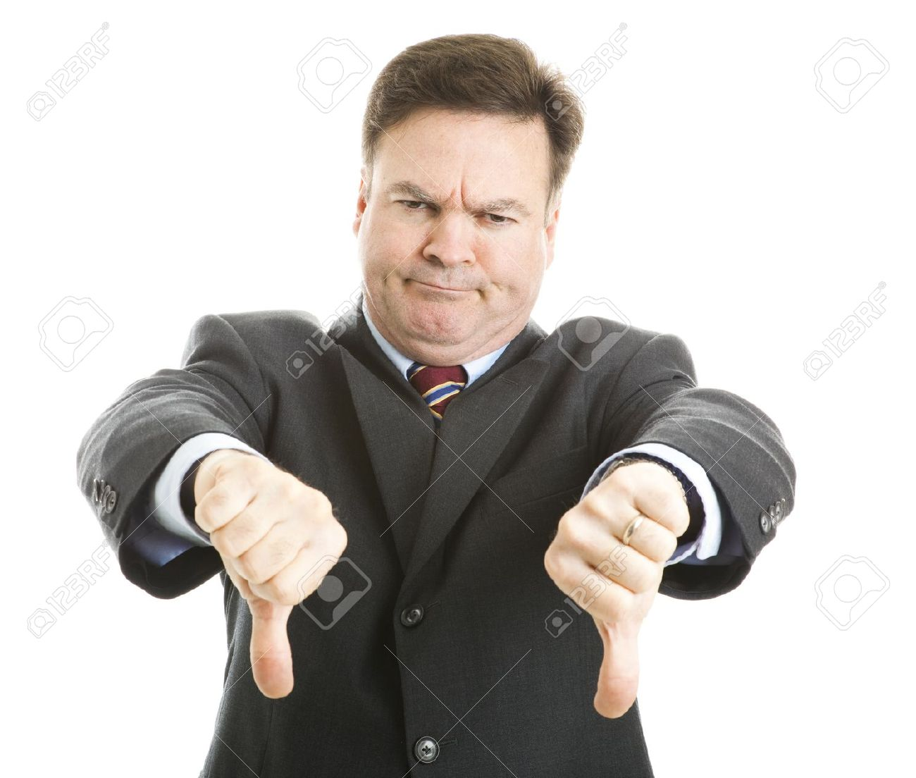 Businessman Frowning And Giving Two Thumbs Down. Isolated On ...