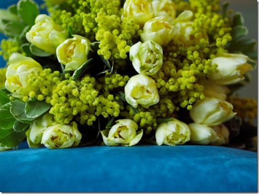 Check out this arrangement of yellow tulips and mimosa by Jane Packer (found