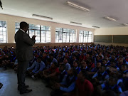 Education MEC Panyaza Lesufi addresses children at the school after a pupil was allegedly raped by classmates.