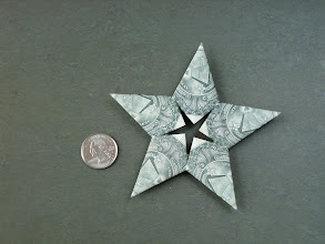 Photo: Model: Money Star;  Front side shown here;  Creator: Trang (Tracy) Chung;  Folder: William Sattler;  5 dollars, one for each point section;  Publication: Annual Collection 2002 (OrigamiUSA) http://www.origami-usa.org/