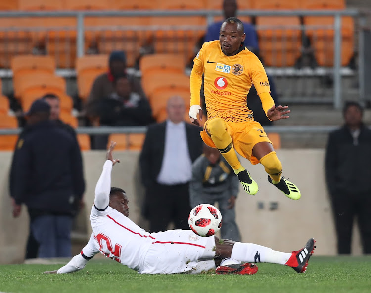 Khama Billiat of Kaizer Chiefs evades tackle from Bangali Keita of Free State Stars during the 2018 MTN8 football match between Kaizer Chiefs and Free State Stars at Soccer City, Johannesburg on 11 August 2018.