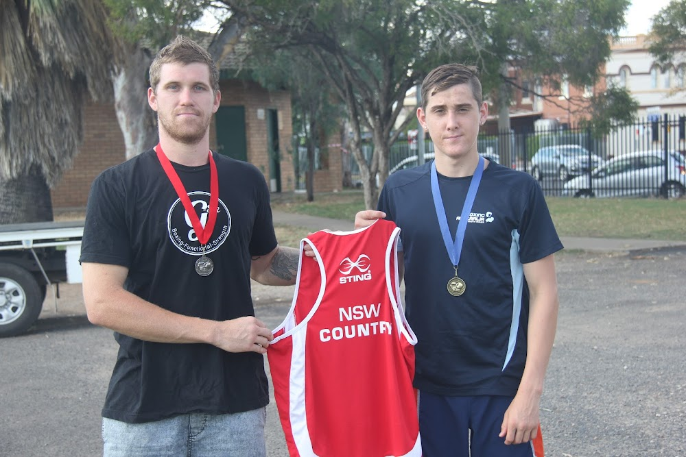 Brendan and Shannan Davey with the medals and uniform they brought home from the City v Country boxing event at the Central Coast on Saturday, December 3.