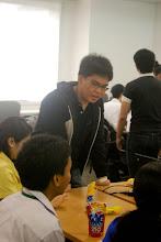 Photo: Kenan assisting the group