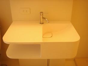 Photo: イタリアのデザイナー作、人工大理石の洗面台。下にタオルなんかを入れる場所があります。
