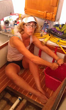 Photo: Anne sponging fresh water out of the bilge