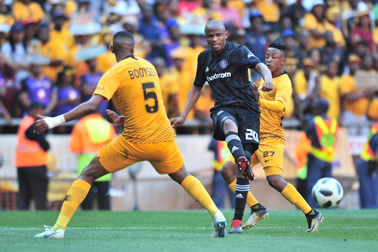 Xola Mlambo of Orlando Pirates challenged by Mario Booysen of Kaizer Chiefs during the Absa Premiership 2018/19 match between Orlando Pirates and Kaizer Chiefs at FNB Stadium, Johannesburg on 27 October 2018.