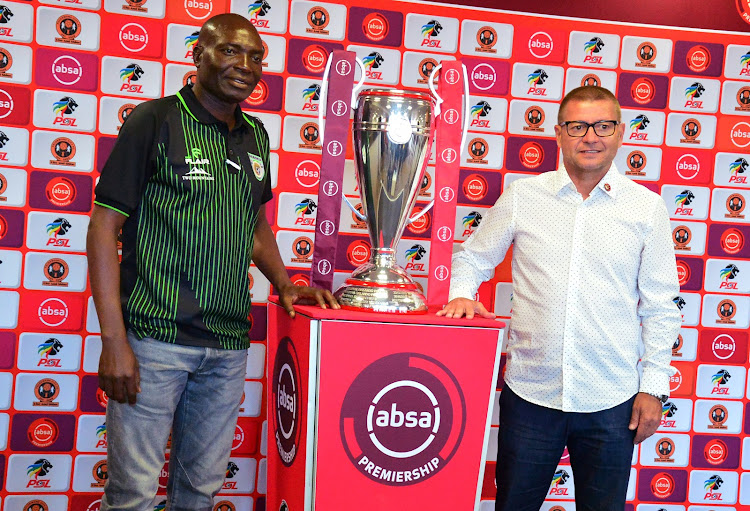 Baroka FC coach Wedson Nyirenda (L) pose for a photograph with the Absa Premiership trophy alongside his Polokwane City counterpart Jozef Vukusic during the Polokwane derby press conference at Peter Mokaba Stadium in Polokwane the on August 16 2018.