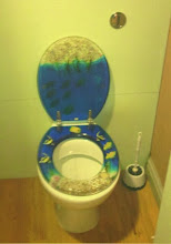 Photo: Not convinced of the efficacy of a pebble dashed / tropical toilet theme at the rear of one of the arcades..