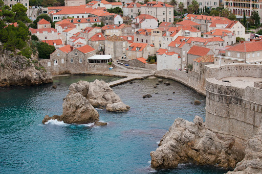 Old-Dubrovnik-and-bay.jpg - The bay meets the edge of Dubrovnik and its charming orange-clad clay rooftops.