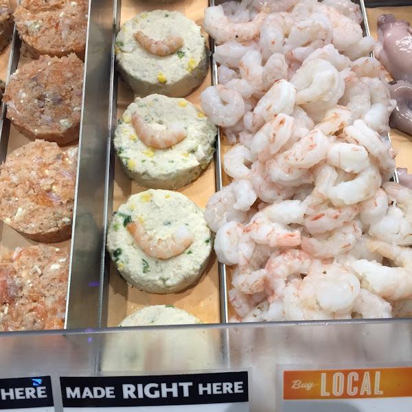 Fresh shrimp touching wheat product.