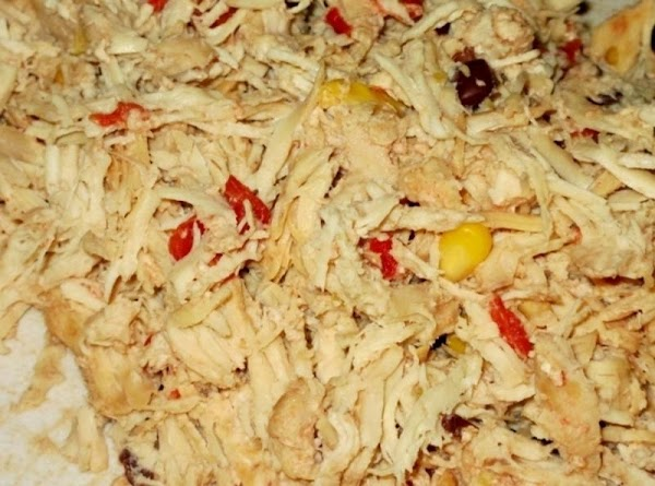 Remove chicken pieces from crockpot and set aside on cutting board.  It's ok...