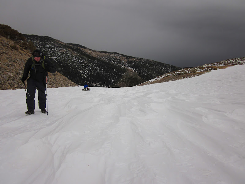 Photo: Coming up over the ridge.  The snow was very uneven and packed.