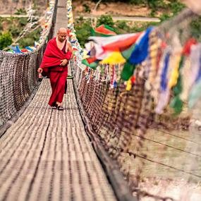 the monk and his drink.... by Debasis Banerjee - People Street & Candids ( buddhism, monk, red, punakha, bhutan, bridge )