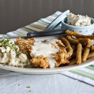 Slow Cooker Chicken Fried Steak With Peppercorn Gravy.