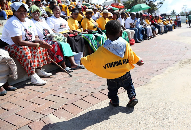 Samthanda Mhize, 1, watches a gathering of about 300 disgruntled ANC members who met at Durban's South Beach Ampitheatre to air their grievances about problems in the ANC. Picture: JACKIE CLAUSEN