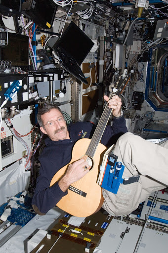 Burbank plays a guitar in the U.S. Laboratory
