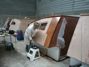 Photo: Covering the deckpods with epoxi and fiberglass