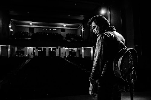 Sad Elvis with empty theater by Florin Marksteiner - People Musicians & Entertainers ( sadness, black and white, theater, guitar, elvis tribute artist, elvis presley, stage, leather,  )