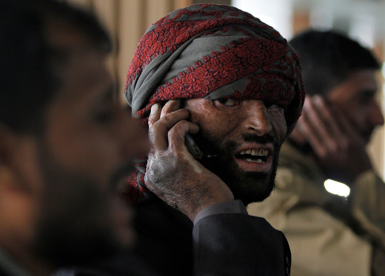 A wounded Houthi fighter talks on the phone as he waits at Sanaa airport during his evacuation from Yemen, December 3 2018. Picture: REUTERS/MOHAMED AL-SAYAGHI