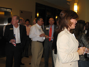 Photo: Mercantile Capital Corporation's guests networking after listening to the 3 candidates. www.504Experts.com