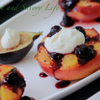 Grilled Peaches with Cheesecake Crème and Blueberry Sauce