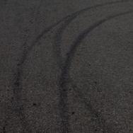 Tire tracks on asphalt