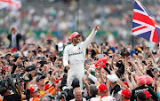 Lewis Hamilton soaks up the adulation of fans after winning his home British Grand Prix.