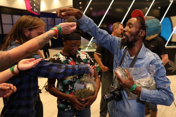 Cannabis activist Steven Thapelo Khundu hands out cannabis buds from a plastic bag at the expo entrance, encouraging attendees to bring them inside, during the opening of the four-day expo in Pretoria, December 13 2018. Picture: REUTERS/SIPHIQE SIBEKO