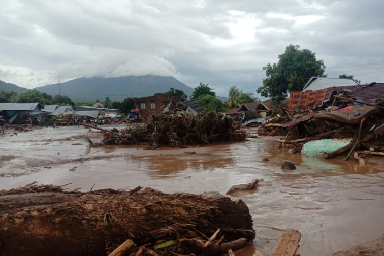 Damaged houses are seen at an area affected by flash floods after heavy rains in East Flores, East Nusa Tenggara province, Indonesia April 4, 2021.