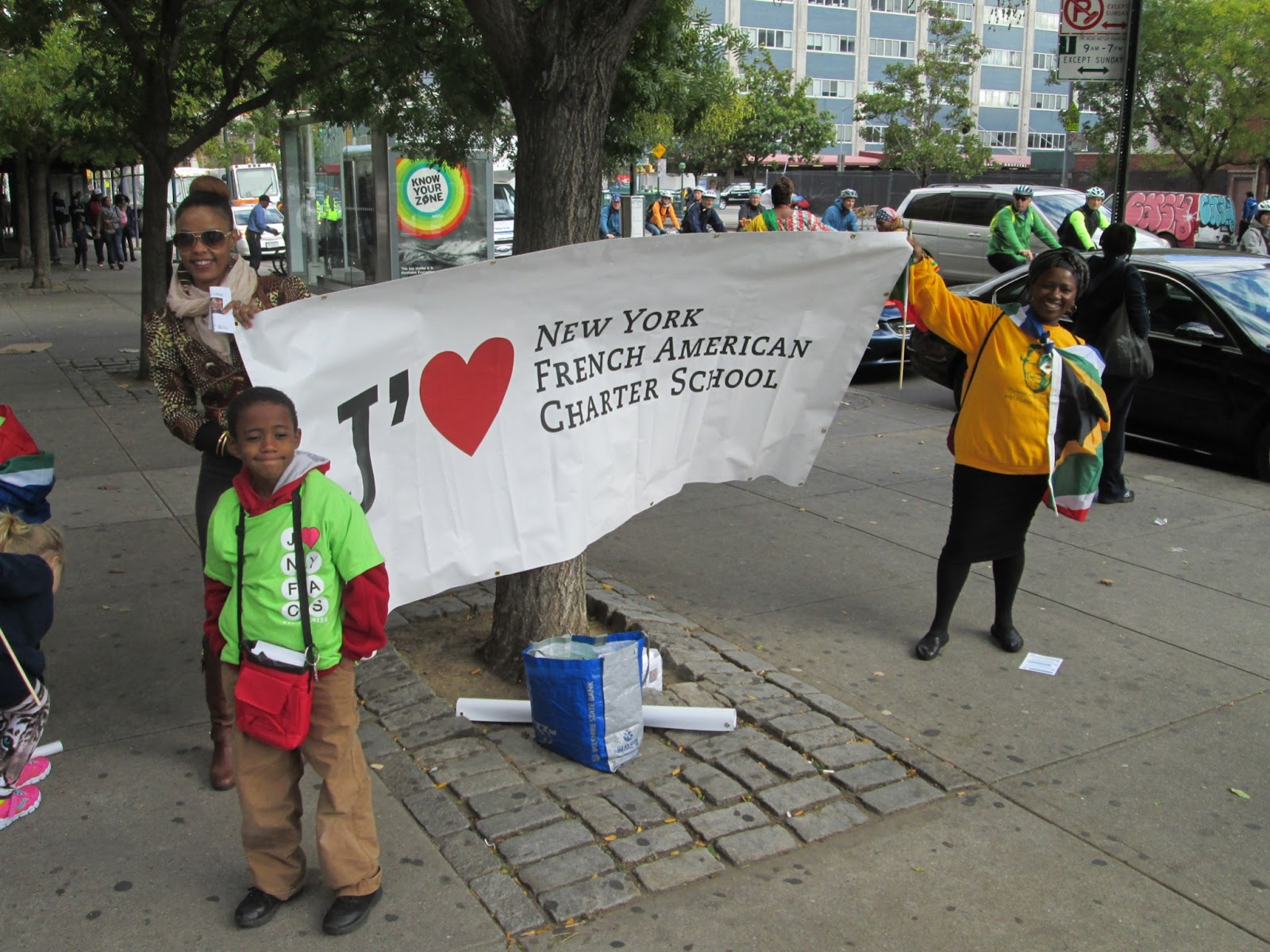 NYFACS students with school banner