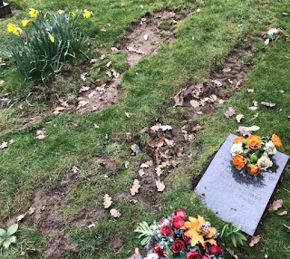 Familes demand answers after graves are damaged