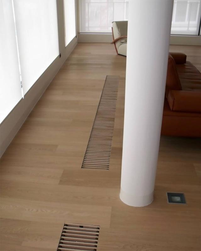 Parketvormen - Oog voor detail - de roosters van de verwarming worden naadloos verwerkt in de parketvloer