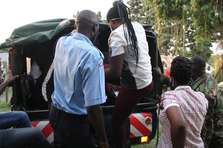 Police officers enter some children who were found engaging in sexual activities in a house at Sango estate in Homa Bay town on July 3,2020